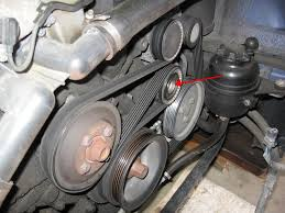 serpentine belt for 318 ti 1997 the red arrow is where the tensioner is you wrench counter clockwise on that a large ratchet there s a cap on it that needs to be pryed off first