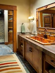 mountain style multicolored tile bathroom photo in other with a trough sink recessed panel