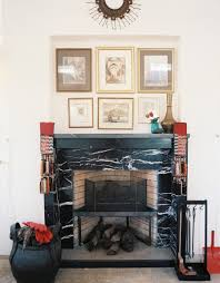 view in gallery black marble fireplace under a wall art display
