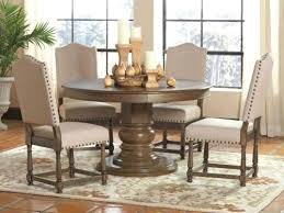 traditional natural ash brown round dining table claremont one