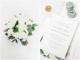 clic wedding invitation with gold wax seal and custom venue ilration