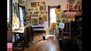 ... playful home art studio with painting wall decor also small workstation  in front of black office ...