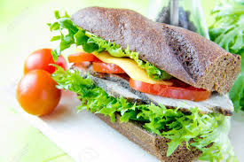 Sandwich Of Black Bread With Beef Cheese And Vegetables Stock Photo
