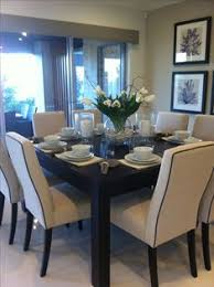 cute dining room set up with a square table