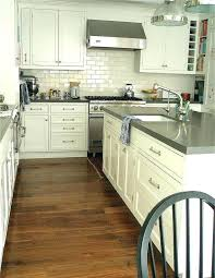white kitchen cabinets with grey quartz countertops dark