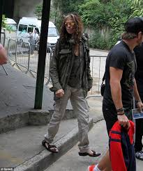 rock star style aerosmith frontman steven tyler shows off his blue pedicure as he steps