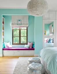 Turquoise blue girl's bedroom features a white feather chandelier, Eos  White Pendant, illuminating a