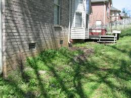 question about re landscaping my backyard building a retaining wall on sloped lot