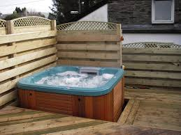 garden decking with a hot tub on it