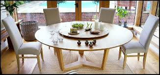 orbit lazy susan round dining table in solid oak or walnut with large round dining table uk