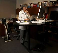 researchers say you burn 15 percent more calories using standing desks photo karen warren