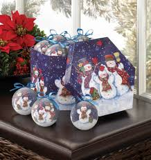 Happy snowmen spend a peaceful wintery night celebrating the season and you  can too when you decorate your holiday tree with this set of ornaments.