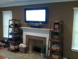 hanging tv brick fireplace mount above where to put cable box wall stone demonstrate components