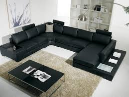 modern living room with blue sofa with modern black leather living
