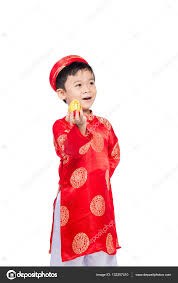 little vietnamese boy in traditional clothes for tet celebration the word mean double happiness it is the gift in lunar new year or tet holiday on red