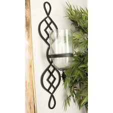traditional black iron and glass candle wall