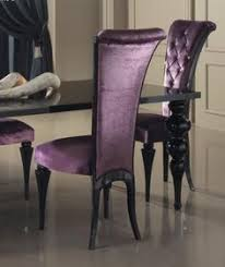 purple velvet and black chairs black table dining room