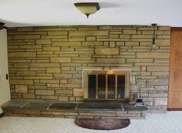 a fireplace surround made of brick or stone can be painted and completely freshen up a