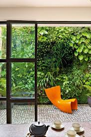 gallery outdoor living wall featuring: outdoor patio living wall with orange accent chair