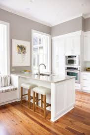 Sherwin Williams Paint Color Requisite Gray - I love the grey walls with  the warm wood floor and the white cabinets and bright light for a kitchen  or any ...