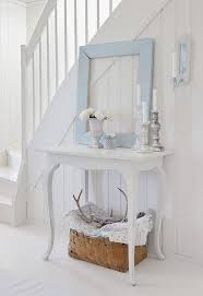 All-white hallway with a pale blue frame decor piece! Simple, clean with