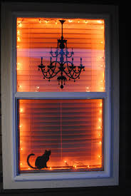 ***Awesome for front window! I love this Halloween window decor idea, with  orange lights and black silhouettes -- it's classy and simple.