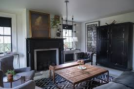 across the entryway is the living room with an eclectic mix sheepskin a
