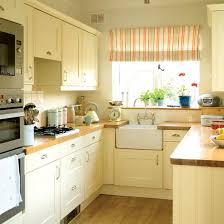yellow country kitchens. Exellent Country A Country Kitchen After My Heartthe Belfast Sink With Bridge Faucet  Wood Floor And Counters Cream Cabinets Lovely Window Fabric Make This A Special  Inside Yellow Country Kitchens