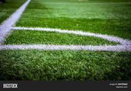 green grass football field. Corner Soccer Field Or Football Texture Background. White Lines On Green Grass. Sport Grass F