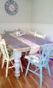 shabby chic rustic dining table and mismatched chairs