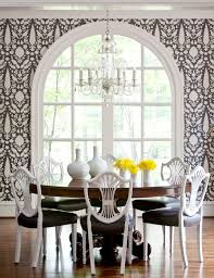 black white wallpaper definitely help define the focal point in this room the window a round table with antique inspired black white dining chairs
