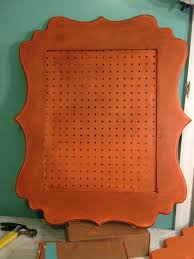 peg board inserted into painted picture frames from hobby lobby