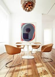the dinning room of a private residence in coimbra portugal duna chairs and dizzie table by lievore altherr molina for arper love those floors