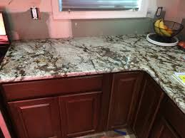 Just Cabinets Aberdeen White Tiger Granite And Hampton Bay Cognac Cabinets Just Looking