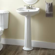 pedestal sink features a fluted tapered pedestal column and an oval basin with a sculpted backsplash pair with a 4 centerset faucet to complement the