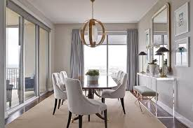 view full size elegant dining room features a brass sphere chandelier over an antique