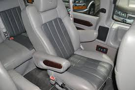 center captains chair gray leather with graphite leather inserts escalade wood trim