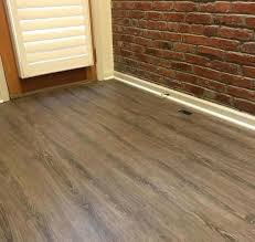 vinyl tile flooring installation picture of installed luxury floor installing