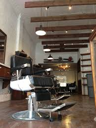 patrons can get a hair cut a hot towel shave and have their shoes shined plus choose from an array of american made s such as sunglasses