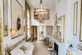 of a grand parisian home exceptionally high ceilings and a multitude of magnificent high windows bring light and grandeur mirrored and gold leafed