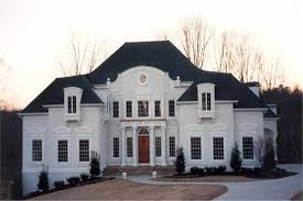 imposing 2 story luxury home design in white with columns on the front porch