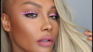 taking a new spin on colourful makeup this tutorial features pink teal and purple eye shadow with white eyeliner this tutorial features easy instructions