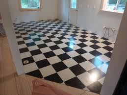 the new black and white vct tiles freshly installed and sealed