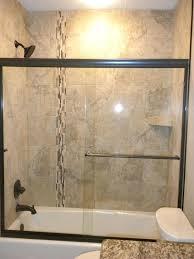 beige bathroom tile ideas bathroom tub shower tile ideas white wall mounted soaking bathtub black mosaic beige bathroom tile