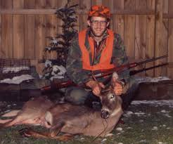 Bare breasted woman with buck deer