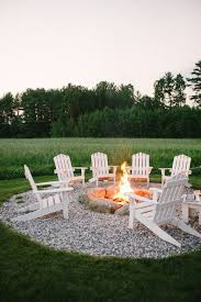 create a beautiful outdoor seating area with gravel and a fire pit from style me
