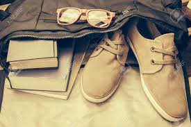stock photo top view of cal life style bag old book notebook red gles and cal shoes from inside bag in vine tone