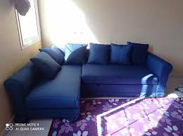 blue ikea sofa bed under storage like