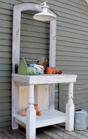 potting bench made from an antique door beadboard porch posts en wire and a working antique light wow via gardens