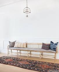 minimal boho entry way with long wood bench and colorful hand woven ...